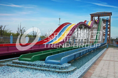चीन Cool Huge Fun Rainbow Water Slides With Custom Length 4 Lanes फैक्टरी